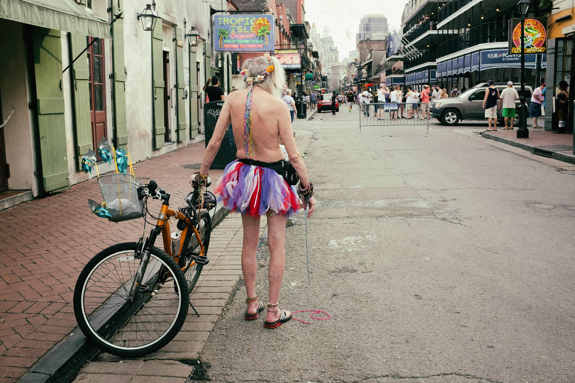 Bourbon Street man in New Orleans by photographer Kevin Brown