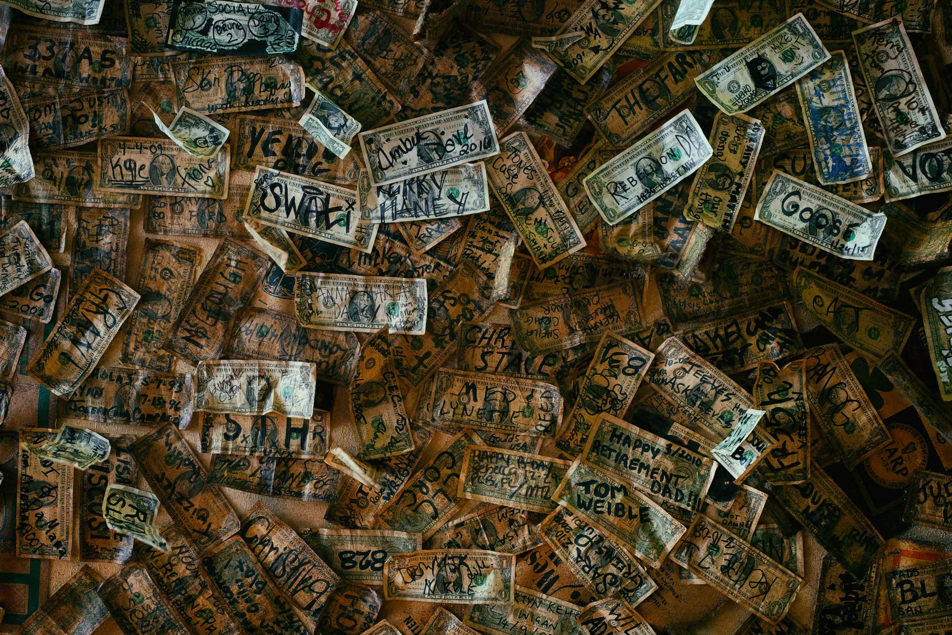 Wall of money in New Orleans by photographer Kevin Brown