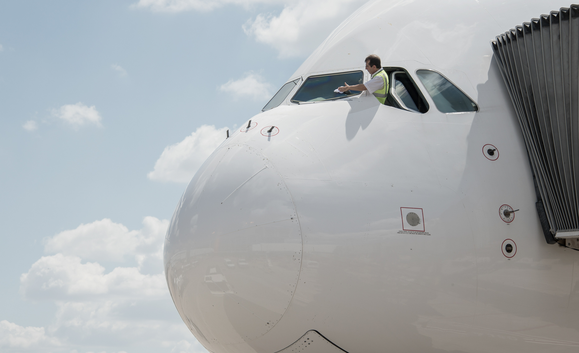 Pilot cleans his windshield at DFW Airport by commercial photographer in Dallas Kevin Brown