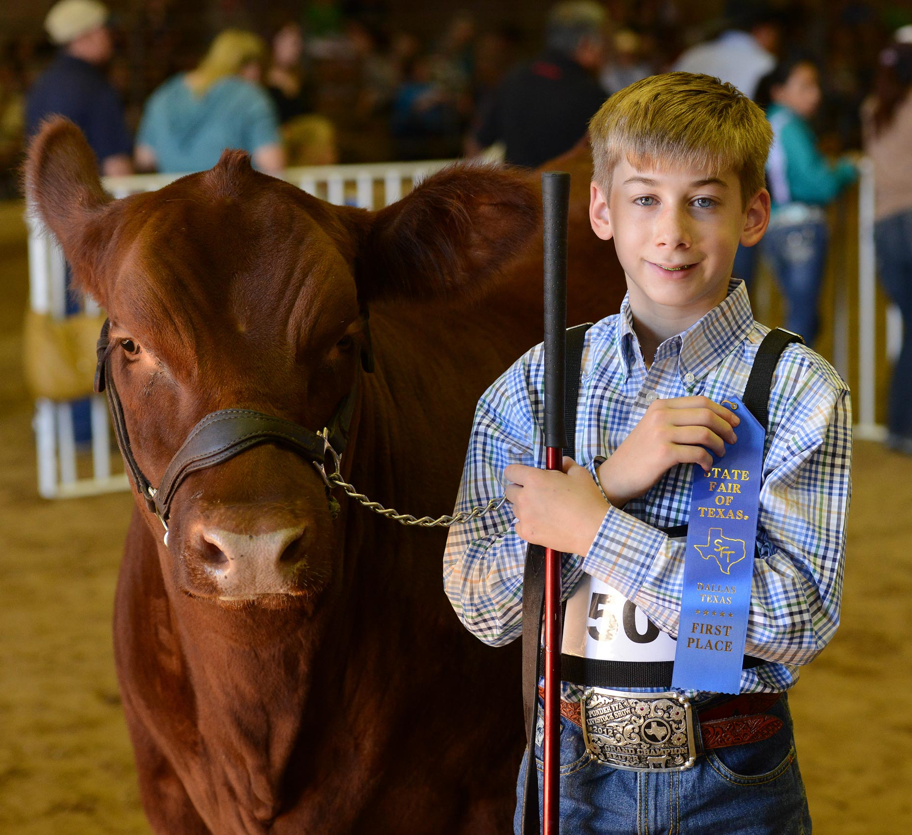 Youth with livestock at The State Fair of Texas. Photography by Kevin Brown