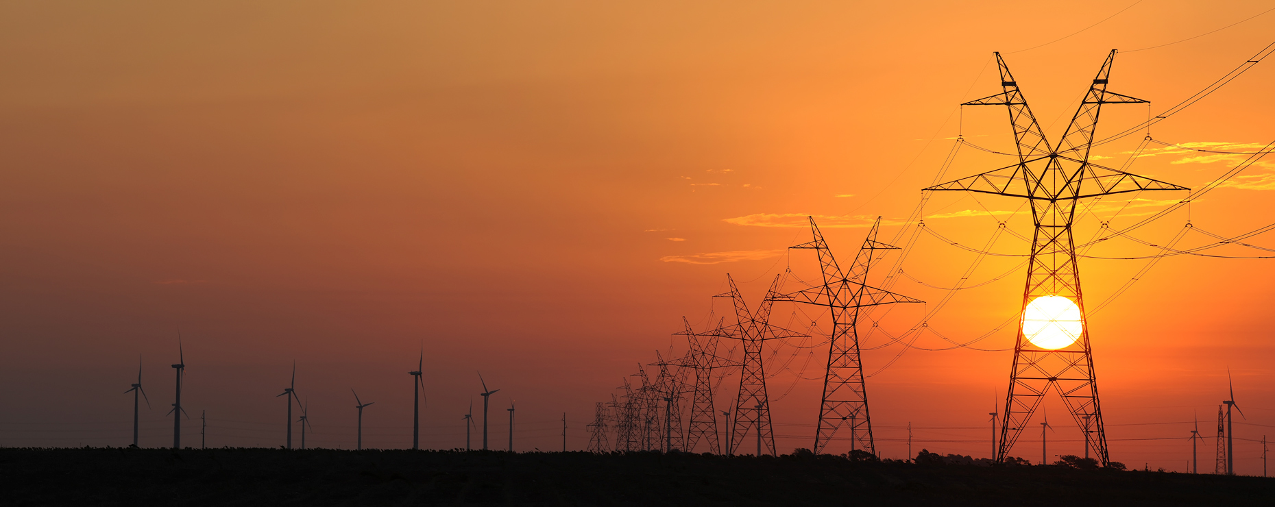 Electric transmission lines and wind turbines in west Texas by industrial photographer Kevin Brown, for Oncor.
