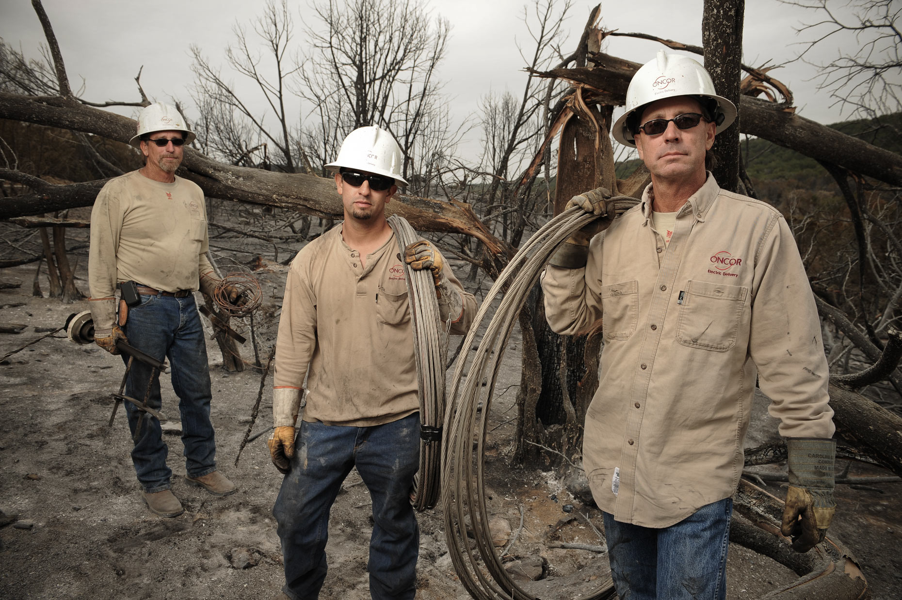 Electric workers after fires working to restore power west of Fort Worth by Kevin Brown.