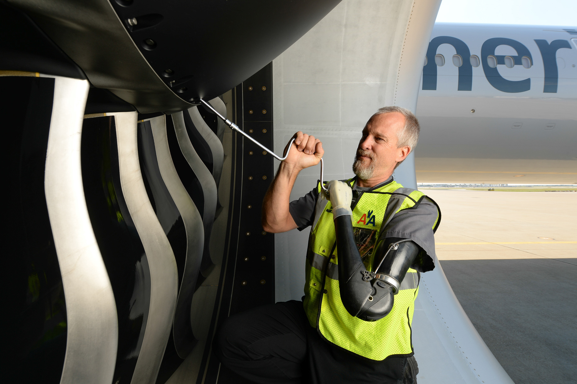 Mechanic for American Airlines at work on an engine at DFW Airport by Kevin Brown Photographer.