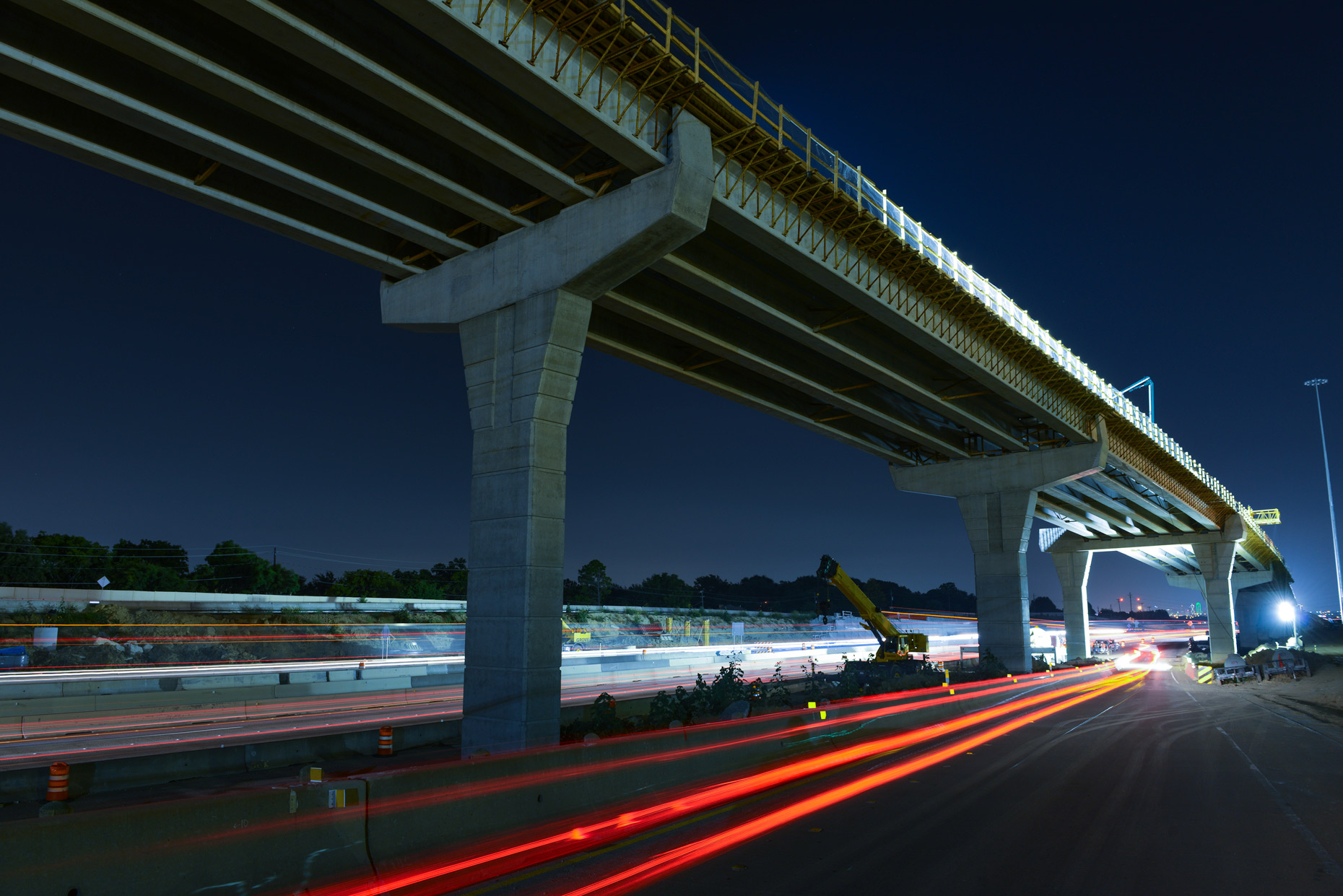 Road construction at night in Grand Prairie, Texas by industrial photographer Kevin Brown.