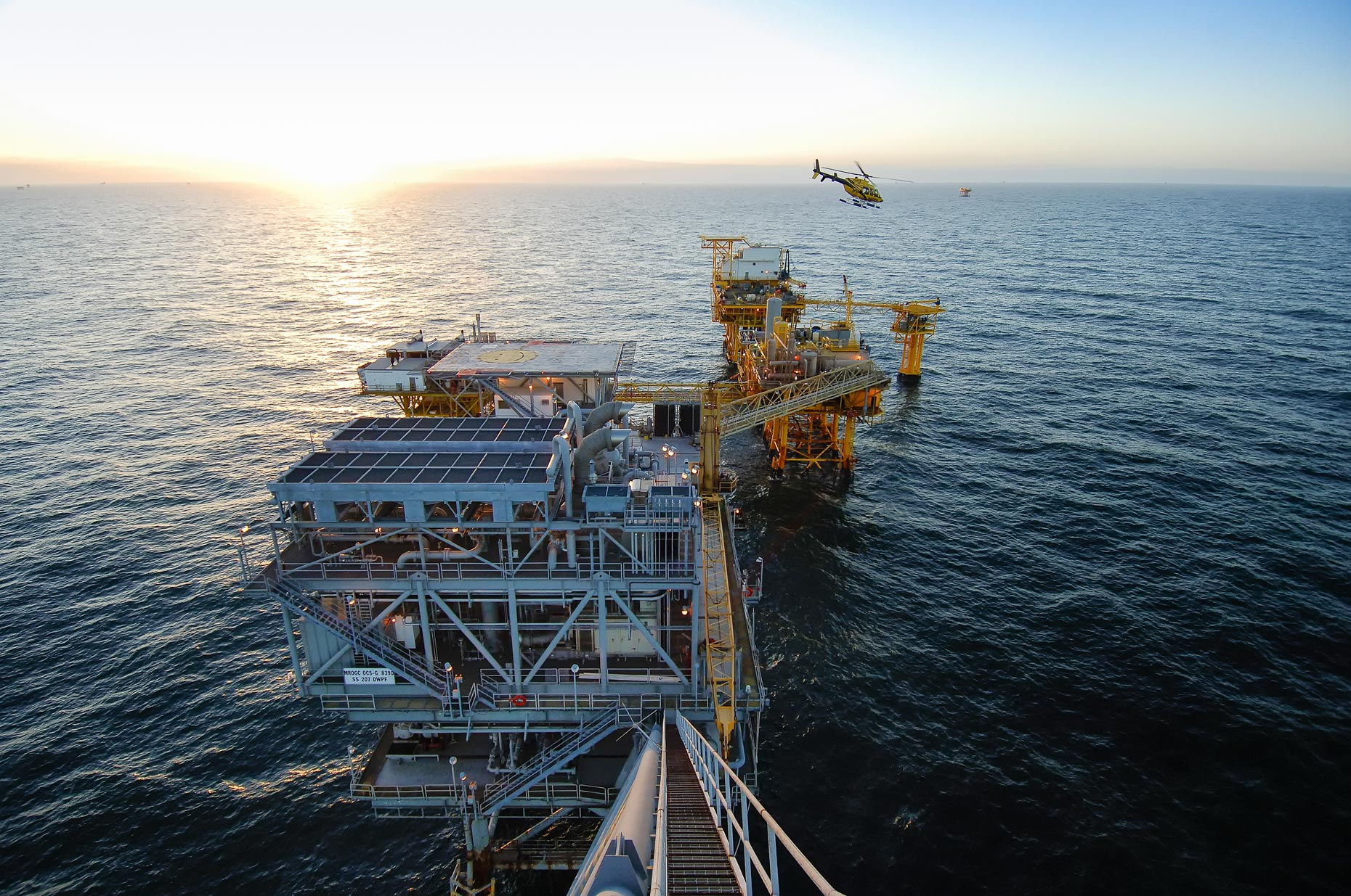 Offshore platform photographed from the boom flare, by industrial photographer Kevin Brown.
